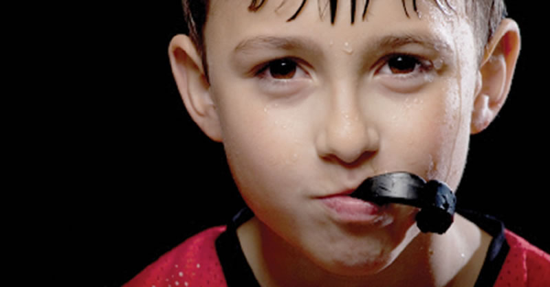 North York dentist - Mouth Guards - boy with sports guard after hockey practice