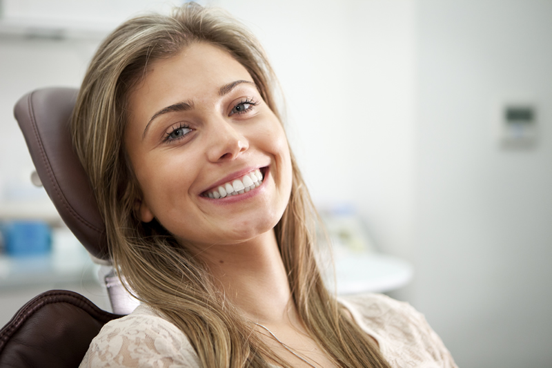 North York dentist - Sleep Dentistry - woman smiling in dental chair