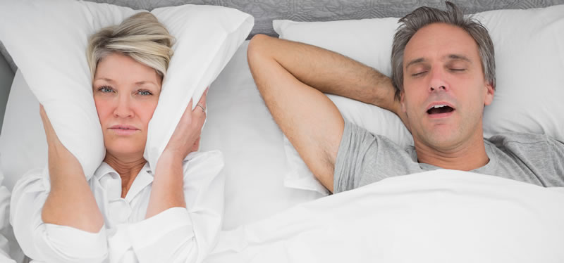 North York Dentist - Snoring & Sleep Apnea - image of man snoring and wife covering ears