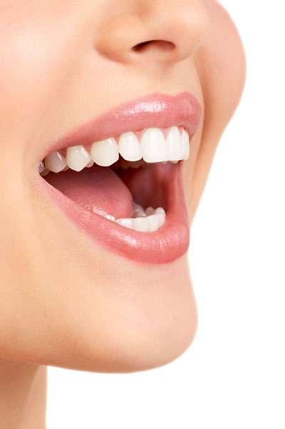 Tooth Colored Fillings - woman smiling showing beautiful teeth